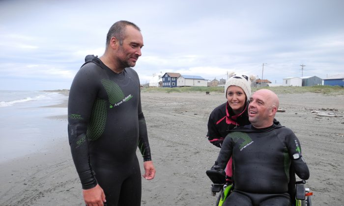 French swimmer Philippe Croizon (R), four-limb amputee, speaks with his friend, swimmer Arnaud Chassery (L), on a beach in Wales, Alaska, on on Aug. 11, 2012.  (Patrick Filleux/AFP/GettyImages)