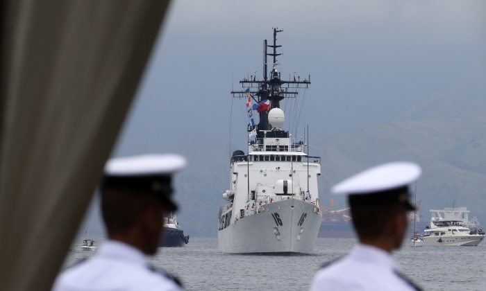 The second warship of the Philippine Navy, the BRP Ramon Alcaraz prepares to dock for a formal welcoming ceremony at Subic Freeport, about 80 kilometers (50 miles) northwest of Manila, Philippines, Tuesday, Aug. 6, 2013. (AP Photo/Bullit Marquez)