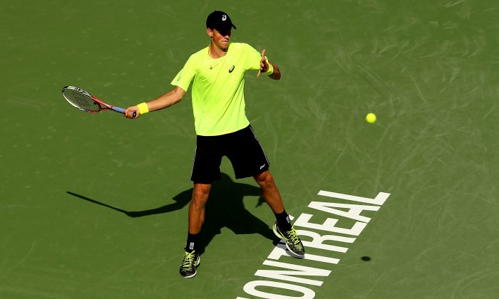 Canada's Vasek Pospisil hits a forehand against John Isner in Rogers Cup first round action at Uniprix Stadium in Montreal on Aug. 6, 2013. (Matthew Stockman/Getty Images)