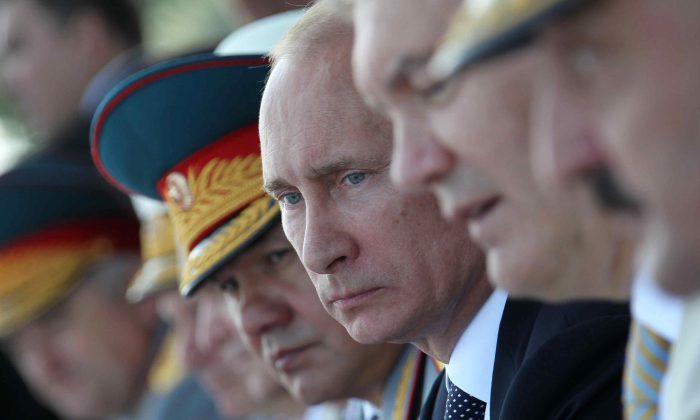 Russian President Vladimir Putin, third right, in Ukraine on July 28, 2013. (AP Photo/RIA-Novosti, Mikhail Klimentyev, Presidential Press Service)