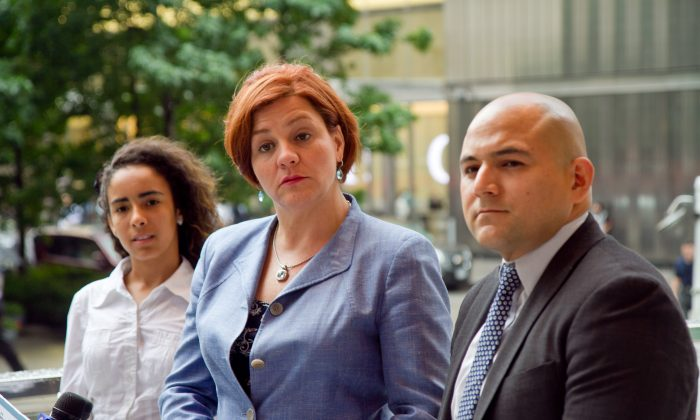 Council Speaker and mayoral candidate Christine Quinn speaks on the steps of Borough of Manhattan Community College on Aug. 1, joined by Bronx Bridges High School principal Pablo Villavicencio and Carmen Pujols, 17, a senior at Bronx Bridges High School. (Joshua Philipp/Epoch Times)