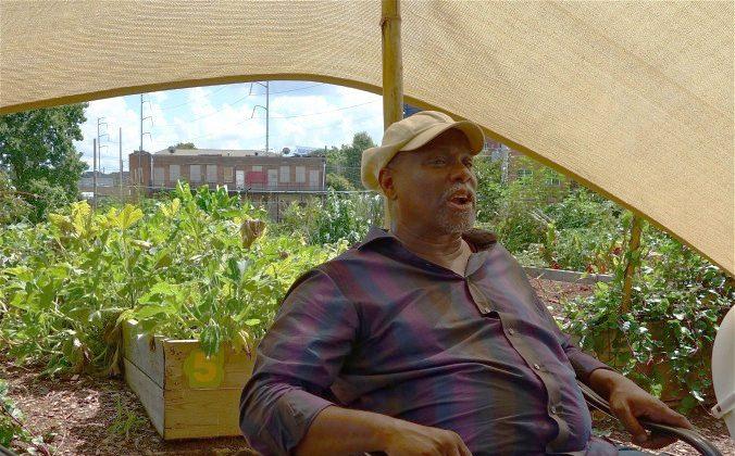 National leader in urban farming Rashid Nuri greets visitors to the Wheat Street Garden near Ebenezer Baptist, which was Martin Luther King's Atlanta church. (Mary Silver/Epoch Times)