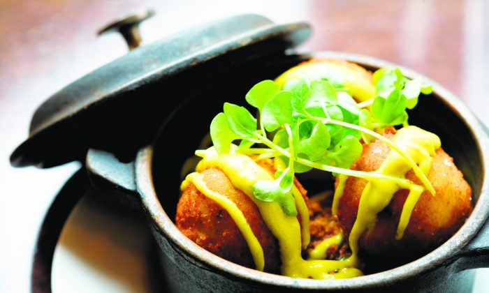Salt Cod Fritters with lamb sausage ragu, and curry aioli. (Frances Janisch)