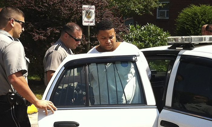 Daniel Rodriguez is put into a squad car outside police headquarters in Johnston, R.I., Monday, Aug. 12, 2013. Rodriguez was arrested Sunday in connection to the slayings of two women and the abduction of 2-year-old Isaiah Perez, who was later found unharmed.(AP Photo/Erika Niewdowski)