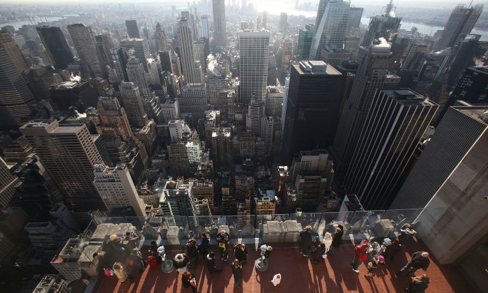 Visitors take in the view at Top of the Rock Observation Deck at 30 Rockefeller Plaza in New York City. Rockefeller Center is among New York buildings using ice to keep cool. (Mario Tama/Getty Images)