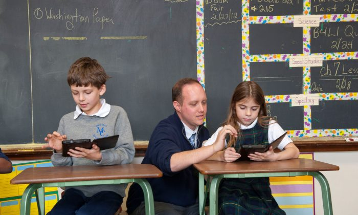 Studies show that increasing student engagement with mobile learning devices such as tablets and smartphones brings improved academic achievement. Schools are increasingly considering allowing students to bring their own devices to school. (PRNewsFoto/Verizon)
