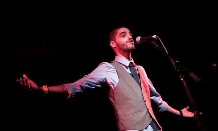 Denver, Colo. poet Shane Romero performs in a semi-final bout at the 2011 National Poetry Slam at the Middle East Upstairs in Cambridge, Mass. The Boston Poetry Slam is on until Aug. 17, 2013. (Marshall Goff/NPS)