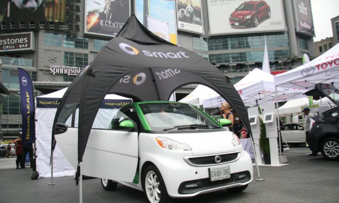 The 2-seater electric Smart car was open for inspection at Dundas Square during the Plug'n Drive Electrical Vehicle Day where visitors could test drive electric vehicles and learn all about them. (Kristina Skorbach/The Epoch Times)
