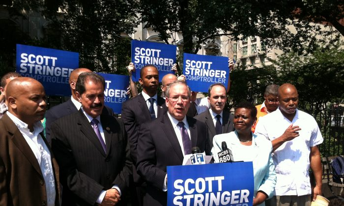 Comptroller candidate Scott Stringer, surrounded by supporters and government officials, announced a program that would help monitor claims costs against the city on Aug. 21, in New York City. (Kristen Meriwether/Epoch Times)