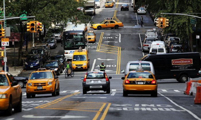 Taxi cabs and other vehicles drive in Manhattan's Upper West Side on October 10, 2012. (Spencer Platt/Getty Images)