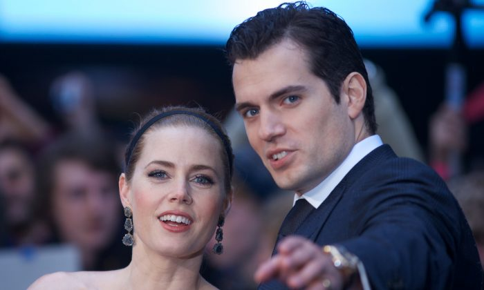 American actress Amy Adams and British actor Henry Cavill pose on the red carpet for the European premiere of the film Man of Steel in London on June 12, 2013. (Andrew Cowie/AFP/Getty Images)