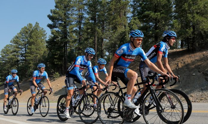 Tom Danielson (2R) and Lachlan Morton (R) lead the Garmin-Sharp team on a training ride in preparation for the USA Pro Challenge on August 19, 2012 in Durango, Colorado. (Doug Pensinger/Getty Images)