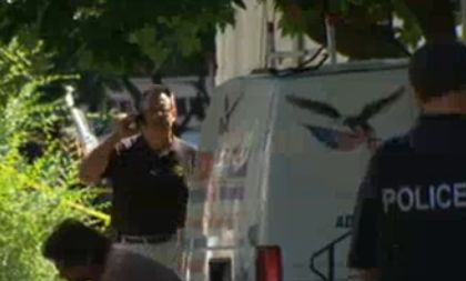 Police gather outside a home on Hobart Avenue, Trenton, N.J., on Aug. 15, 2013, after two officers were shot outside the home and the suspected shooter was killed by return fire. (Screenshot/NBCPhiladelphia.com)