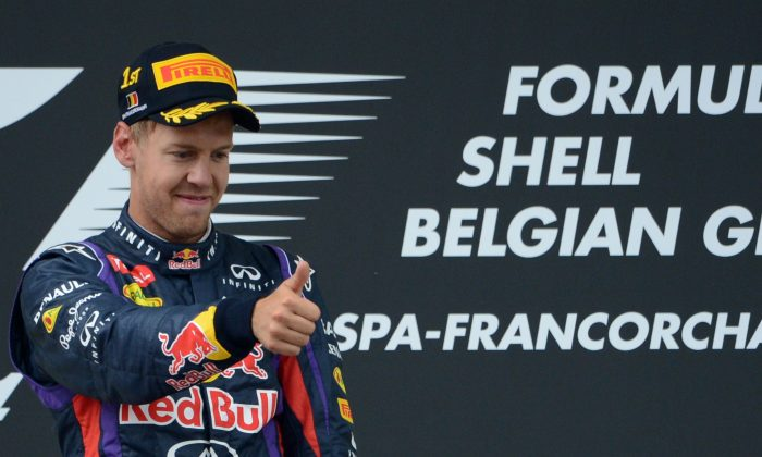 Red Bull Racing's Sebastian Vettel celebrates on the podium at the Spa-Francorchamps ciruit in Spa on August 25, 2013 after the Belgium Formula One Grand Prix. (John Thys/AFP/Getty Images)