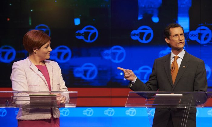 New York City Democratic mayoral candidates Christine Quinn, (L), listens as fellow candidate Anthony Weiner speaks during their first primary debate for New York City mayor at the WABC/Channel 7 studios, Tuesday, Aug. 12, 2013 in New York. (AP Photo/New York Daily News, James Keivom)