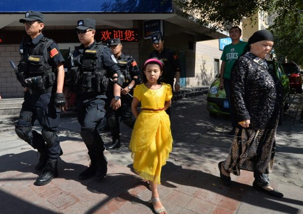 Chinese armed police patrol the streets of the Muslim Uighur quarter in Urumqi on June 29, 2013 after a series of recent terrorist attacks hit the Xinjiang region. Security forces short four Uyghurs dead recently. (Mark Ralston/AFP/Getty Images)