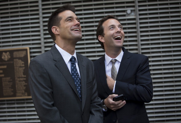 Spencer Rascoff, chief executive officer of Zillow Inc., right, stands with Michael Smith, chief executive officer of StreetEasy, in front of the Nasdaq MarketSite in New York, U.S., on Monday, Aug. 19, 2013. Zillow Inc., operator of the largest U.S. real-estate website, agreed to acquire StreetEasy for $50 million in cash to expand its coverage of the New York market. (Eells/Bloomberg via Getty Images)