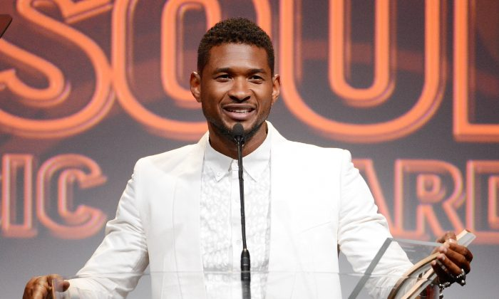 """In this June 27, 2013 file photo shows Usher accepts the golden note award at the 26th Annual ASCAP Rhythm & Soul Music Awards in Beverly Hills, Calif. Usher's ex-wife asked for an emergency custody hearing a day after one of the pair's sons nearly drowned in a pool at the singer's Atlanta home. A lawyer for Tameka Foster Raymond filed the request in Fulton County Superior Court on Tuesday, Aug. 6. The court filing says the boy """"suffered a near-death accident"""" while left unsupervised in a pool at the Grammy winner's home. A judge has set a hearing for Friday. (AP Photo/ASCAP, Phil McCarten, File)"""