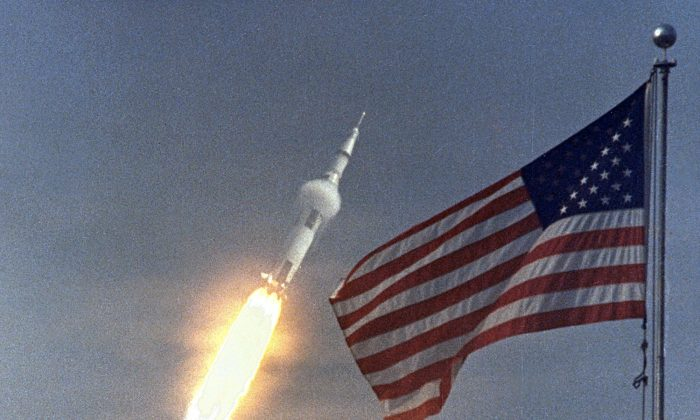 In this NASA handout picture taken on July 16, 1969, the American flag heralds the flight of Apollo 11, the first lunar landing mission. (AFP/Getty Images)