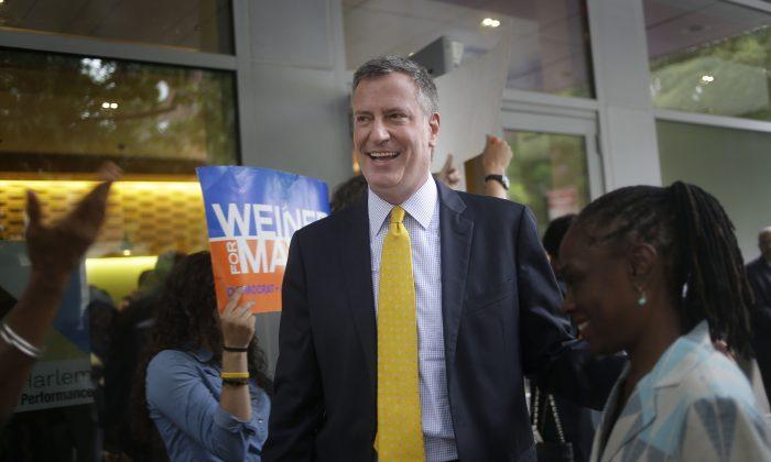 Democratic mayoral hopeful Bill de Blasio leaves a candidate forum in New York, Tuesday, Aug. 13, 2013. (AP Photo/Seth Wenig)