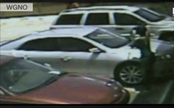 A screenshot of a video caught of parents leaving their infant in a parking lot in New Orleans, published by News Breaker.