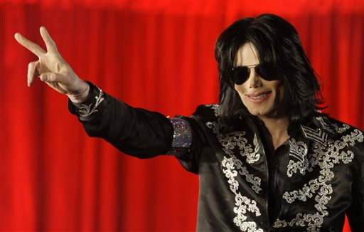 In this March 5, 2009, file photo, Michael Jackson makes an announcement about upcoming performances at the London O2 Arena. (AP Photo/Joel Ryan, File)