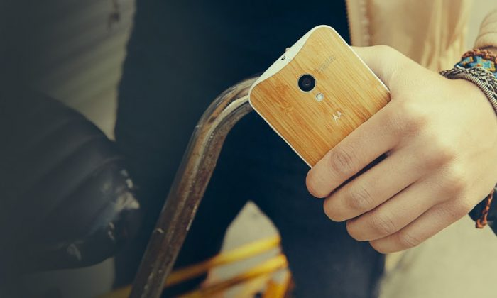 A promotional image on Motorola's website shows a person holding a Moto X phone. Google and Motorola announced the Moto X phone today. (Motorola)