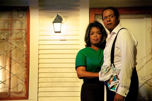 """This undated file film image provided by The Weinstein Company shows Oprah Winfrey as Gloria Gaines, left, and Forest Whitaker as Cecil Gaines in a scene from """"Lee Daniels' The Butler."""" (AP Photo/The Weinstein Company, Anne Marie Fox, File)"""