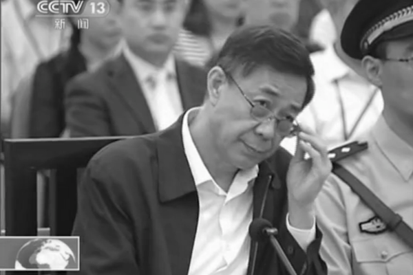 This screen grab from CCTV shows disgraced former Politburo member Bo Xilai on trial in the Jinan Intermediate Court in Shandong Province on Aug. 25. Bo continued to defend himself against almost all charges, although remarks regarding his role in attempting to cover up his wife's role in the murder of Neil Heywood may have shown some remorse. (Epoch Times)