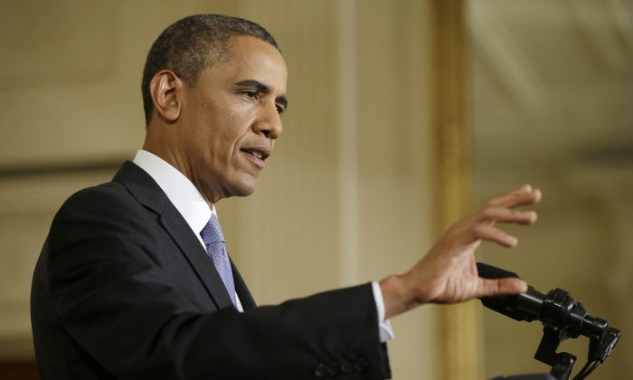 President Barack Obama gestures during his news conference in the East Room of the White House in Washington, Friday, Aug. 9, 2013. (AP Photo/Pablo Martinez Monsivais)