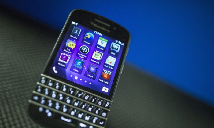 A BlackBerry Q10 appears on display at the company's Annual and Special Meeting, in Waterloo, Ontario on  July 9, 2013. (AP Photo/The Canadian Press, Geoff Robins)