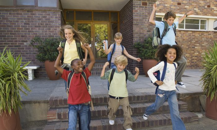 A new study shows that kids who attend after school programs regularly over several years have improved performance at school and better social skills.  (Jupiterimages/Photos.com)
