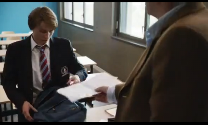 """An August 5, 2013 photo of a scene in Dans la Maison, a 2012 French film, where a sixteen-year-old boy, Claude, hands in his first assignment that describes the """"middle-class woman"""" he is watching as he visits his classmate's house. This and other assignments triggers the ultimate events that unfold in the acclaimed movie """"unapproved"""" by the Chinese Communist Party, yet reportedly due for a private screening at Beidaihe this year. (Putlocker)"""