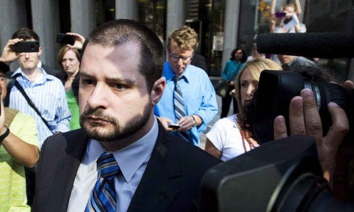 Constable James Forcillo, who has been charged with second degree murder in the shooting of 18-year-old Sammy Yatim, leaves a Toronto courthouse Tuesday after being granted bail. A former Saskatchewan police chief says police training in dealing with people with mental health issues needs to be standardized across the country. (The Canadian Press/Nathan Denette)