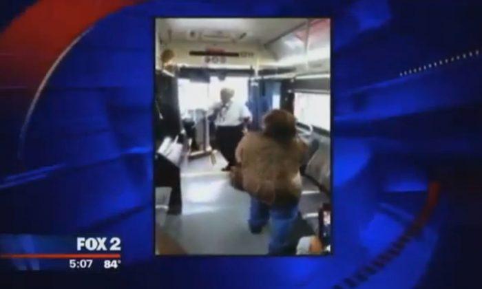 A driver and a passenger got into a fight on a Detroit bus. (Screenshot of Fox2 video)