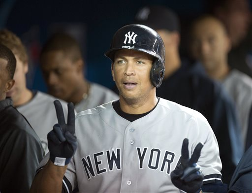 A-Rod celebrates in the dugout after hitting a solo home run against the Toronto Blue Jays during the fifth inning of a baseball game in Toronto on Monday, Aug. 26, 2013. (AP Photo/The Canadian Press, Frank Gunn)