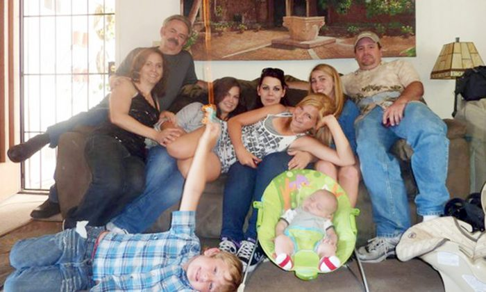 """FILE - In this June 2011 file photo provided by Andrea Saincome, Hannah Anderson, center, reclining across the laps of others, and James Lee DiMaggio, right, pose for a picture with other members of the extended Anderson and Saincome families. Via a social media site, Hannah Anderson says longtime family friend DiMaggio """"tricked"""" her into visiting his house, tying up her mother and younger brother in his garage before escaping with her to the Idaho wilderness. Anderson says she cried all night after being rescued and learning that her family members were found dead at DiMaggio's burning house. Seated from left are: Christina Anderson; Christopher Saincome; Christina's sisters Samantha Saincome and Andrea Saincome; their niece Hannah Anderson, reclining; Alexi (last name unavailable, friend of Hannah's), and DiMaggio. On the floor are Ethan Anderson, left, and Andrea's infant child, whose name was not provided. (AP Photo/Courtesy of Andrea Saincome, File)"""