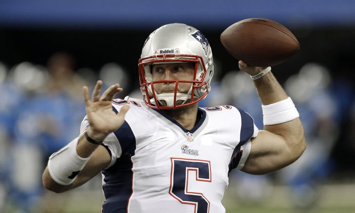 This photo taken Aug. 2013 shows New England Patriots quarterback Tim Tebow throwing during warmups before a NFL preseason football game against the Detroit Lions in Detroit. (AP Photo/Paul Sancya)