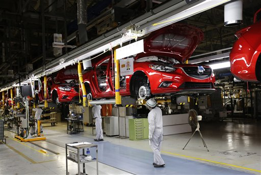 Mazda employees work on the assembly line of the Mazda6 (Atenza) model at its plant in Hofu, Yamaguchi prefecture, southwestern Japan, Tuesday, Aug. 27, 2013. (AP Photo/Shizuo Kambayashi)