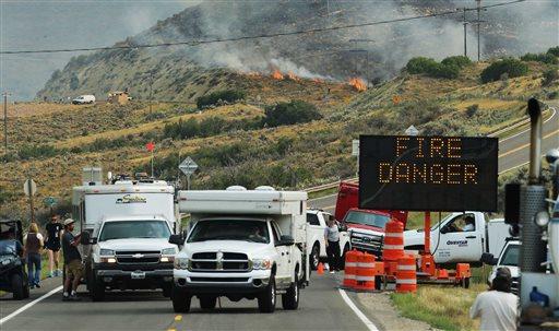 Area residents evacuate as crews work to fight a fire burning near Rockport reservoir, near Wanship, Utah, Tuesday, Aug. 13, 2013. (AP Photo/Deseret News, Scott G Winteton)