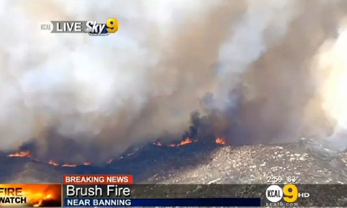 A screenshot of CBS Los Angeles shows the fire.