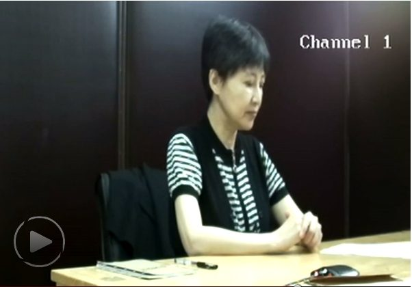 A video testimony of Gu Kailai, the wife of former Politburo member Bo Xilai, was shown in court on the second day of Bo's trial in Jinan, Shandong Province, on Aug. 23. (Screenshot/Epoch Times)