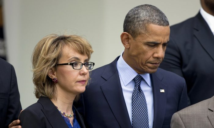 In this April 17 photo, President Barack Obama stands near former Arizona Rep. Gabrielle Giffords before speaking in the Rose Garden about measures to reduce gun violence. (Manuel Balce Ceneta/AP Photo)