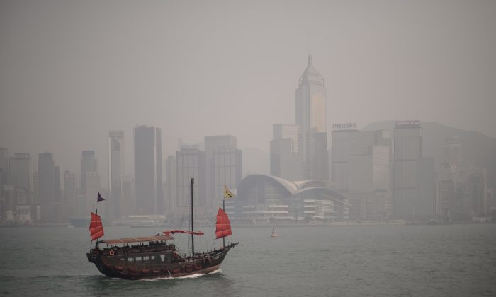 A junk sails past the city's skyline shrouded in a dense blanket of toxic smog in Hong Kong on April 15, 2013. Following a storm, Hong Kong is hazy. (Philippe Lopez/AFP/Getty Images)