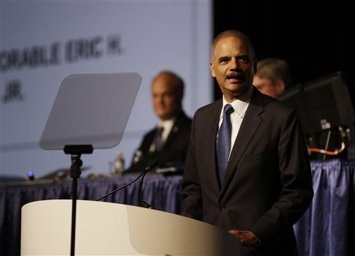Attorney General Eric Holder speaks to the American Bar Association Annual Meeting Monday, Aug. 12, 2013, in San Francisco. In remarks to the association, Holder said the Obama administration is calling for major changes to the nation's criminal justice system that would cut back the use of harsh sentences for certain drug-related crimes. (AP Photo/Eric Risberg)