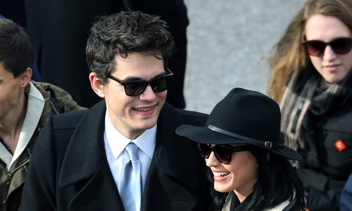 Musicians John Mayer and Katy Perry attend the presidential inauguration on the West Front of the U.S. Capitol, in Washington, D.C., on Jan. 21, 2013. (John Moore/Getty Images)