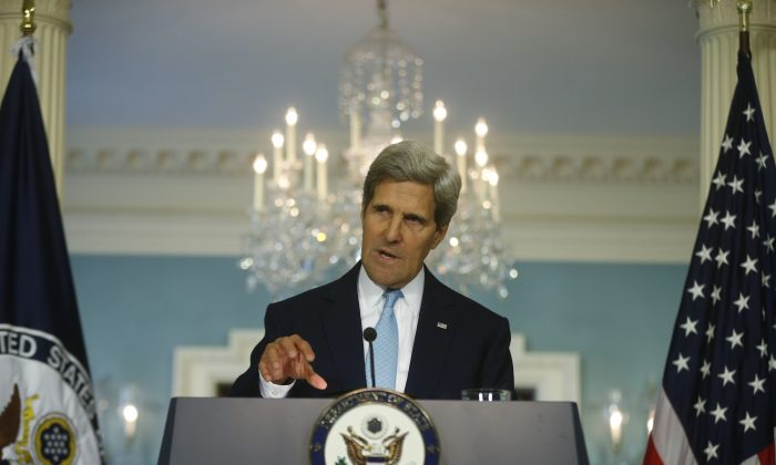 Secretary of State John Kerry makes a statement about Syria at the State Department in Washington, Aug. 30, 2013. Kerry presented evidence showing the Syrian regime used a chemical attack to kill 1429 people. (AP Photo/Charles Dharapak)