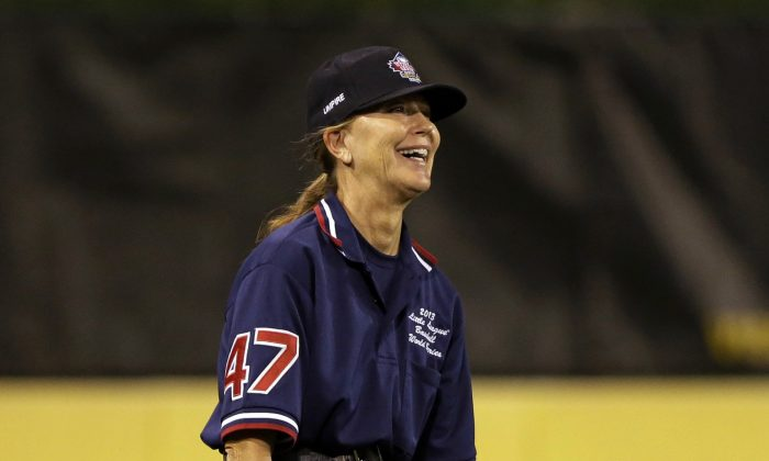 Little League World Series umpire Cynthia Smith works in left field during a baseball game between Chula VIsta, Calif. and Westport, Conn. at the Little League World Series tournament in South Williamsport, Pa., Wednesday, Aug. 21, 2013. Smith, of Ft. Lauderdale, Fla., is only the fifth female in 67 years to be selected a member of the 12 person umpiring crew for the Little League World Series. (AP Photo/Gene J. Puskar)
