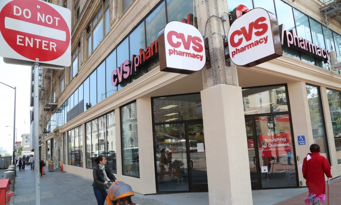 Pedestrians pass by a newly constructed CVS pharmacy at the corner of Market and 7th Streets in San Francisco, July 30, 2013. The chain store, slated to open in mid-August in the South of Market neighborhood, has replaced a check-cashing outlet, cafés, and a liquor store that shut down at the same location. (Christian Watjen/Epoch Times)
