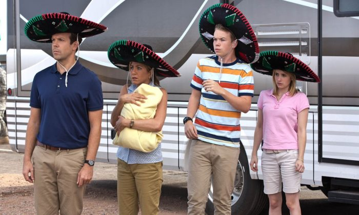 Jason Sudeikis, Jennifer Aniston, Will Poulter, and Emma Roberts play a fake family that was given the mission to smuggle weed across the Mexican border. (Warner Brothers via The Movie Blog)